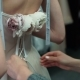 Stylist Helps To Tighten the Corset of a Historical Dress on Woman. Back View - VideoHive Item for Sale
