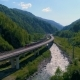 The Modern Train Goes On A Bridge Bend In A Beautiful Mountain Canyon - VideoHive Item for Sale