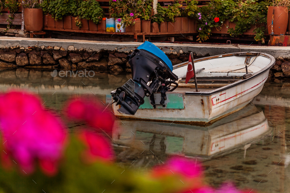 Boat in small fishers village - Stock Photo - Images