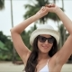 Young Beautiful Woman Enjoying Summer Vacation and Dancing on the Beach - VideoHive Item for Sale