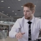 In Showroom Red-haired Bearded Consultant Man in White Shirt Talks - VideoHive Item for Sale