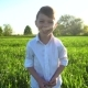 Portrait of a Funny Boy in a Field at Sunset - VideoHive Item for Sale