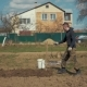 A Man Digs the Ground with a Shovel - VideoHive Item for Sale