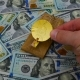 Preparation of Mouse Trap with Gold Bitcoin on the US Dollars Background - VideoHive Item for Sale