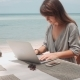 Young Woman Works on Laptop in Outdoor Cafe - VideoHive Item for Sale