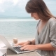 Happy Young Woman Works on Laptop in Outdoors Cafe - VideoHive Item for Sale