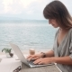 Happy Young Beautiful Woman Finished Her Work in Laptop on the Beach - VideoHive Item for Sale