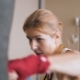 Young Woman Training with a Punching Bag in a Boxing Club. - VideoHive Item for Sale