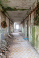 Long corridor in an abandoned and desolate building - PhotoDune Item for Sale