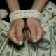 Bound Hands Against the Background of Dollars. - VideoHive Item for Sale