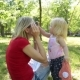 Woman and Child Playing in the Park - VideoHive Item for Sale