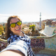 Young woman making selfie in Park Guell, Barcelona, Spain.  - PhotoDune Item for Sale