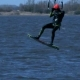 Male Kiteboarder Rides on a Board along the River - VideoHive Item for Sale