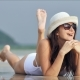 Young Beautiful Woman in Sunglasses Relaxing and Sunbathing at Tropical Beach - VideoHive Item for Sale