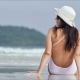 Young Woman in White Swimsuit Relaxing on Tropical Beach - VideoHive Item for Sale