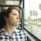 Young Woman Looking out the Window of the Bus - VideoHive Item for Sale