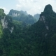 Aerial View of Limestone Rocks Covered with Lush Tropical Greenery. Top View of Mountains in Krabi - VideoHive Item for Sale
