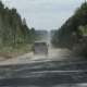 The Car Is Driving Along the Forest Road - VideoHive Item for Sale