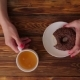 Women's Hand Holding Donut. Woman Eating Donut - VideoHive Item for Sale