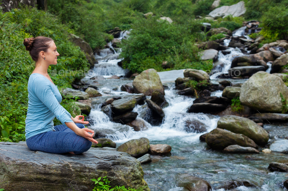 Woman in Padmasana outdoors - Stock Photo - Images