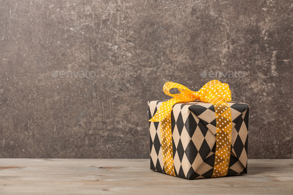 Wrapped gift box on wooden table - Stock Photo - Images