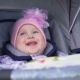 Сute Little Girl Sitting in Baby Carriage and Smiling on the Street, Nature - VideoHive Item for Sale