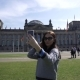 Young Smiling Woman Doing Self Portrait on Smartphone at Reichstag Building in Berlin - VideoHive Item for Sale