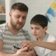 Dad Shows His Son How the Camera Works - VideoHive Item for Sale