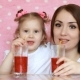 Mother and Daughter Drink Smoothies through a Straw and Smile - VideoHive Item for Sale