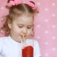A Happy Child Is Drinking Smoothies Through a Straw and Smiling.  Portrait of a Cute Girl Who Enjoy - VideoHive Item for Sale