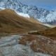Road Running down to Amazing Touristic Place near River in Mountain Valley - VideoHive Item for Sale