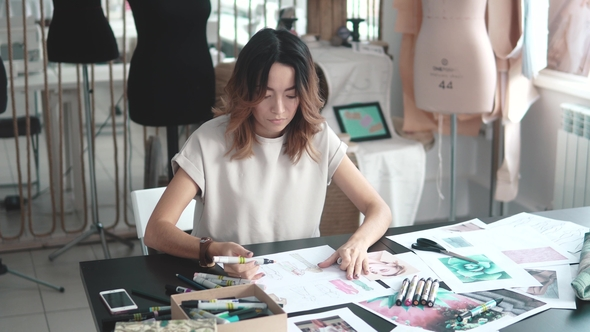 image of a t-shirt designer in her studio