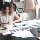 Designer of Clothes Makes a Sketch of Clothes in a Sewing Workshop. a Girl Working for Herself Is - VideoHive Item for Sale