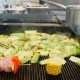 Fried Fuming Vegetable on the Grill on a Blurry Restaurant Kitchen Background. Pepper, Zucchini - VideoHive Item for Sale