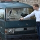 Man Inspects a Broken Minibus - VideoHive Item for Sale