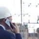 Angry Engineer Screaming on the Phone against a Power Plant Background - VideoHive Item for Sale