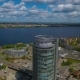 Aerial Survey of a Skyscraper Near a River with a Bridge - VideoHive Item for Sale