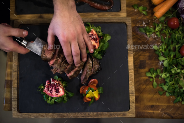 top view of Chef hands serving beef steak - Stock Photo - Images