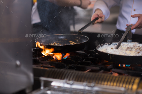 chef preparing food, frying in wok pan - Stock Photo - Images