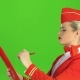 Girl Writes a Pen in a Special Folder, She Is a Flight Attendant. Green Screen. Side View - VideoHive Item for Sale