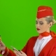 Stewardess Girl in a Red Suit Is Picking Up the Credit Card Code. Green Screen - VideoHive Item for Sale