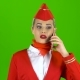 Girl Stewardess Is Talking on the Phone and Is Happy. Green Screen - VideoHive Item for Sale