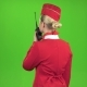 Stewardess Speaks on the Walkie Talkie. Green Screen. Back View - VideoHive Item for Sale