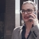Business Girl with Glasses Is in the Rain and Talking on the Phone - VideoHive Item for Sale
