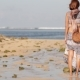 Woman with Fashionable Stylish Nude Rattan Bag on the Beach. Tropical Island of Bali - VideoHive Item for Sale