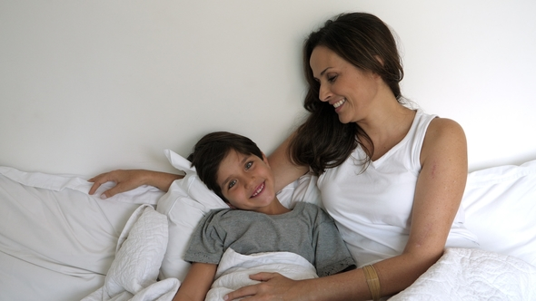 Smiling Mom And Son In Bed Stock Footage
