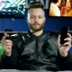 Young Man with a Beard Holds a Smartphone and a Joystick in His Hands - VideoHive Item for Sale