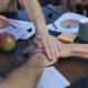 Business People Teaming Together Putting Their Hands on Each Other on Table - VideoHive Item for Sale