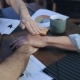 Business People Putting Their Hands on Each Other on Table for Teamwork - VideoHive Item for Sale