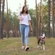 Girl Playing with Her Dog in the Forest at Sunset - VideoHive Item for Sale